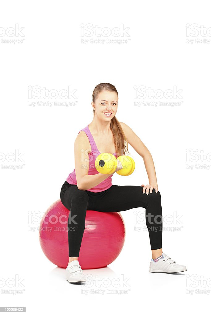 Smiling female lifting up a dumbbell royalty-free stock photo