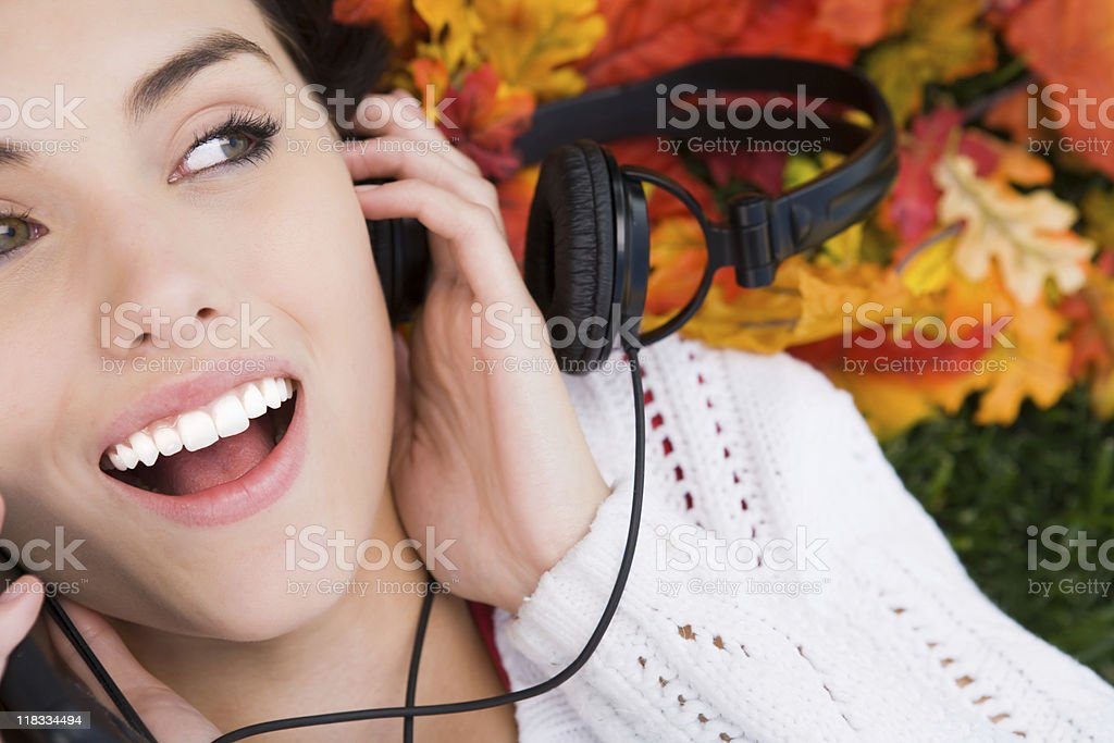 Smiling female listening to music royalty-free stock photo