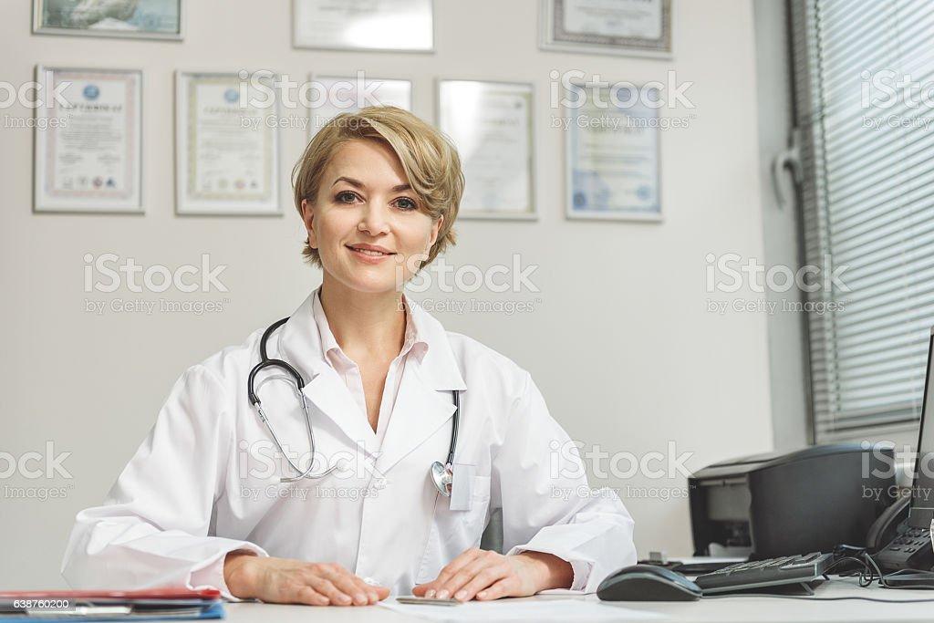Smiling female medico doing her work stock photo