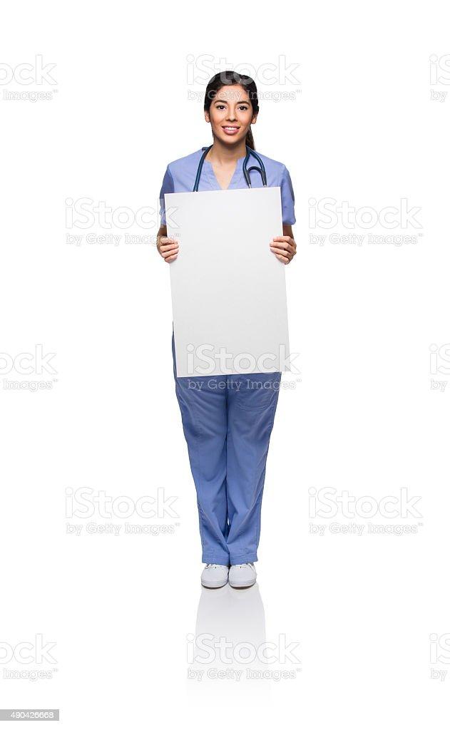 Smiling female nurse with placard stock photo