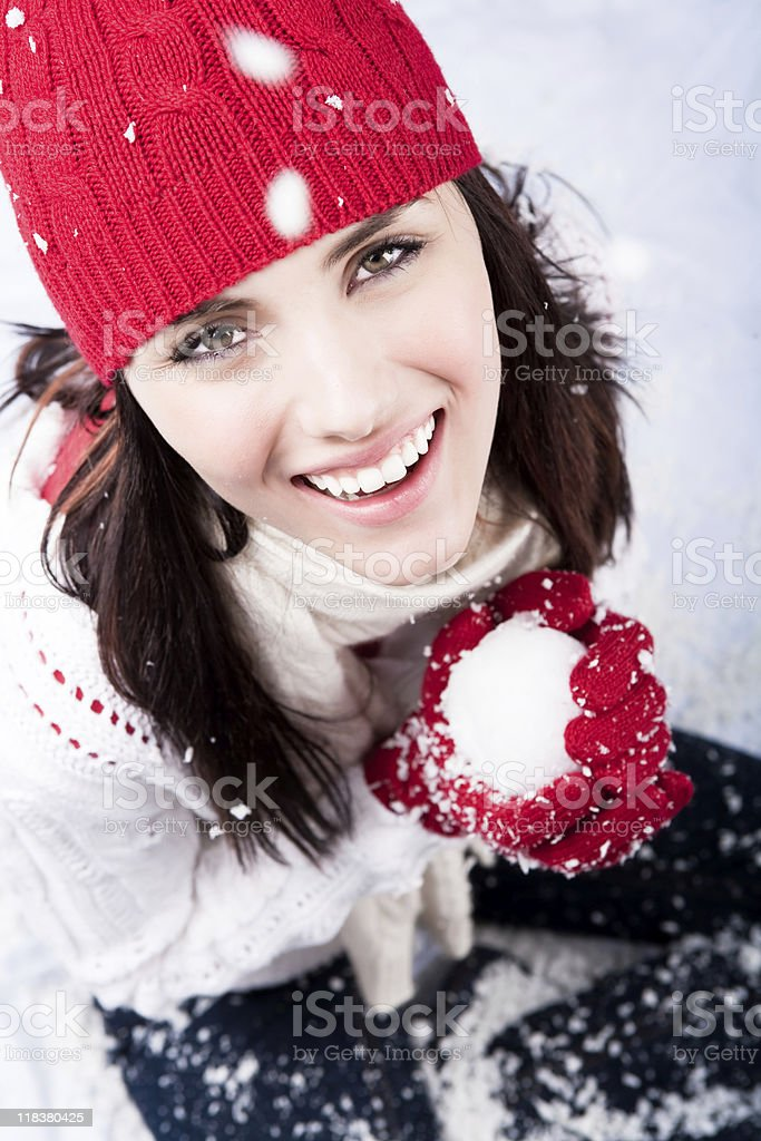 Smiling female playing with snow royalty-free stock photo