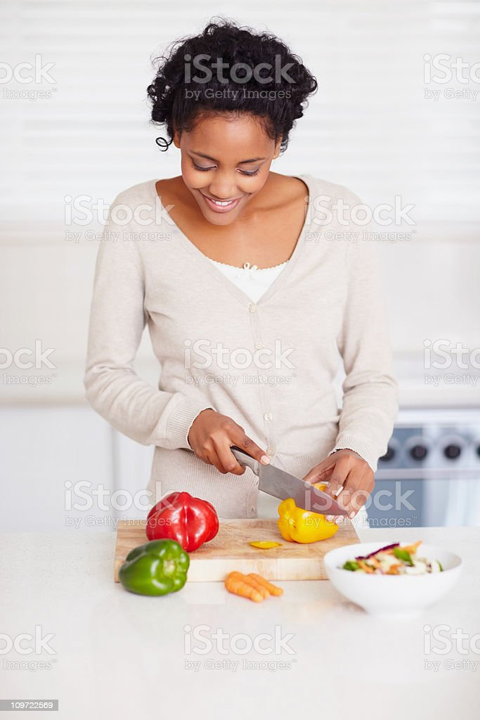Smiling female preparing food in the kitchen royalty-free stock photo