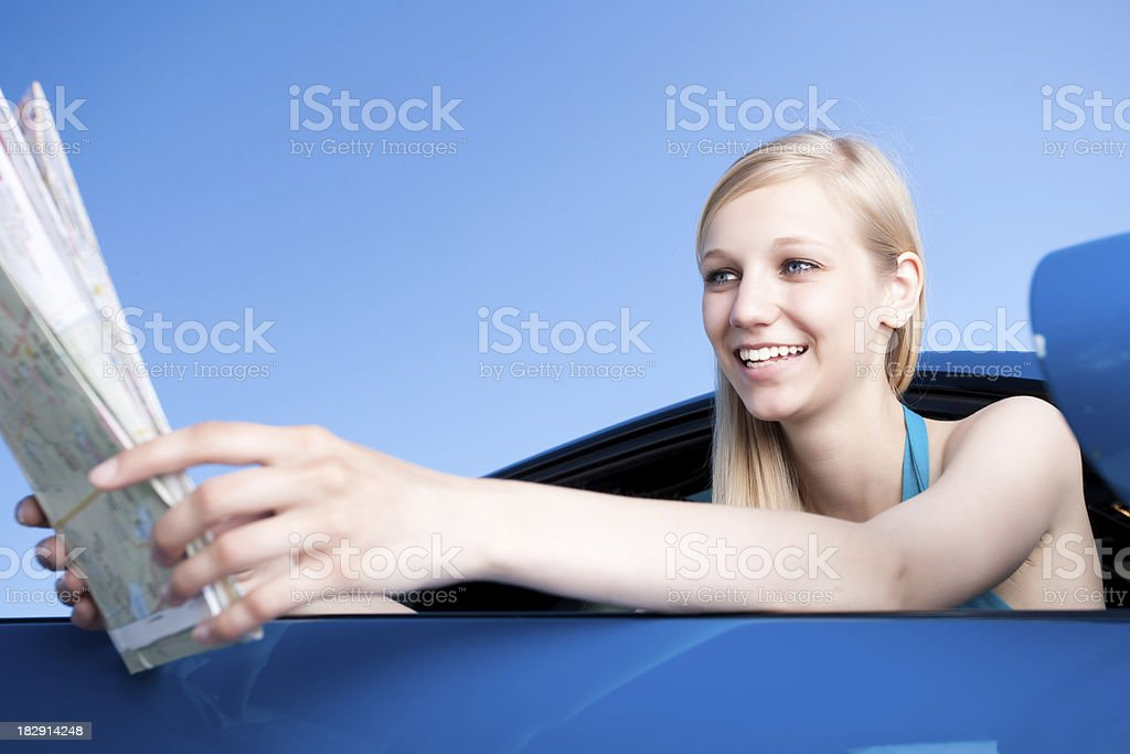 Smiling female reading a map royalty-free stock photo