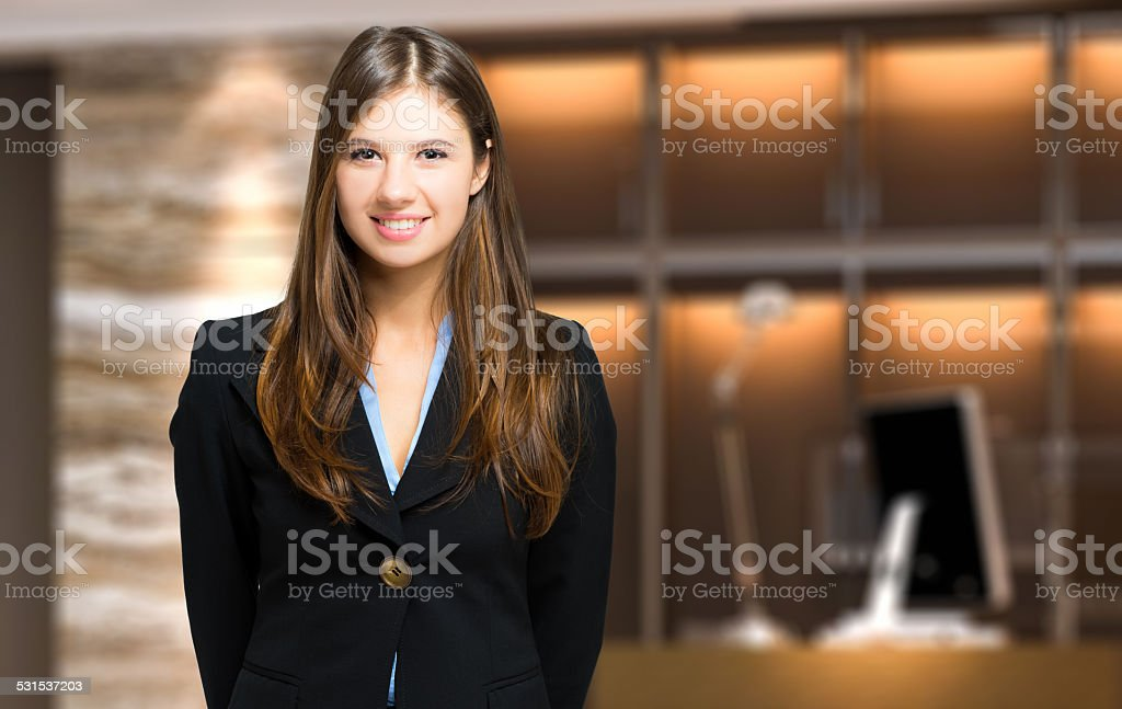 Smiling female receptionist stock photo