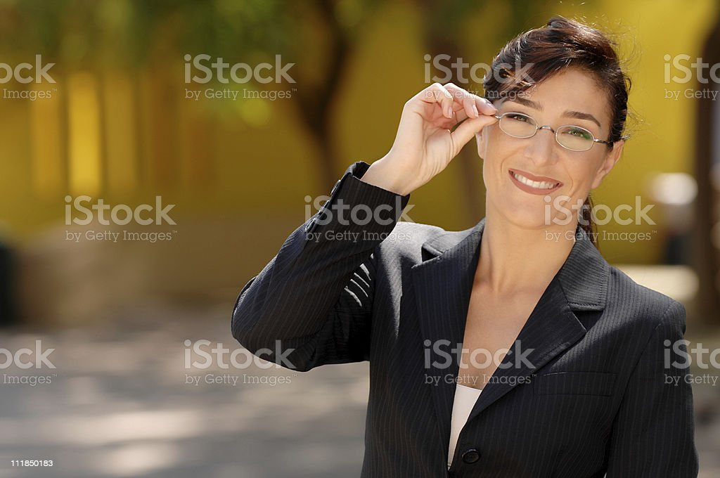 Smiling Female Schoolteacher Business Woman Lawyer Adjusting Glasses royalty-free stock photo