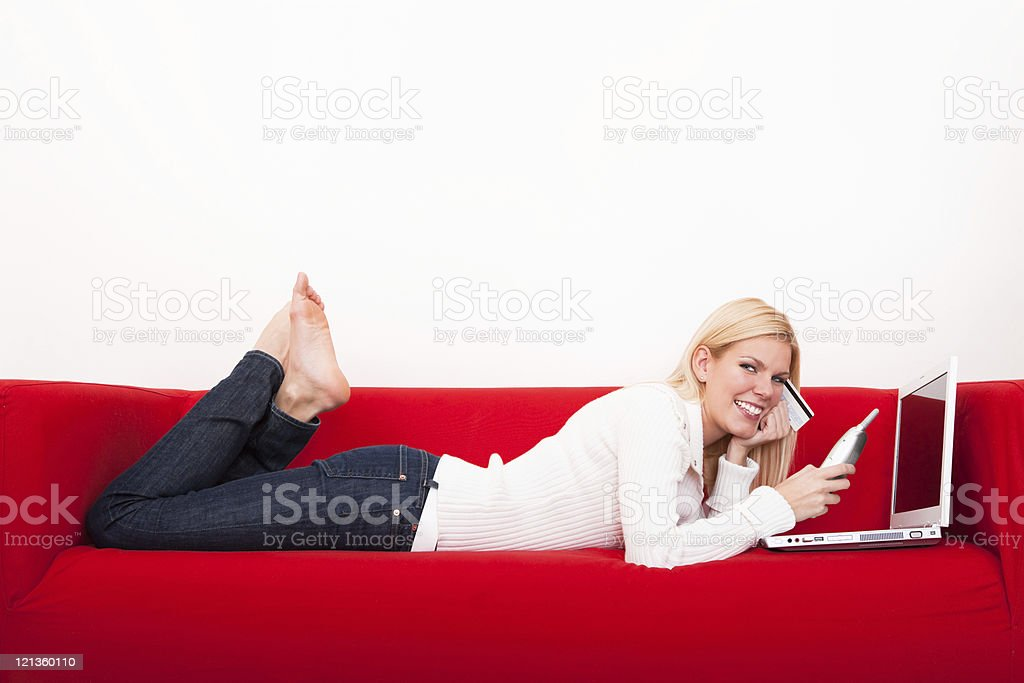 Smiling female shopping online royalty-free stock photo
