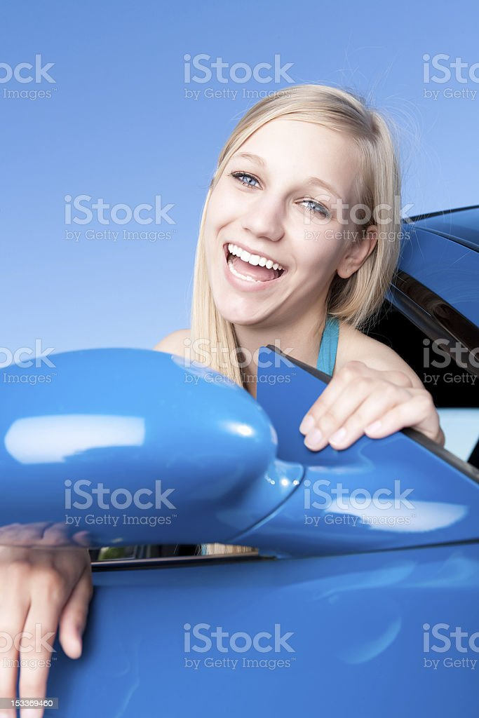 Smiling female sitting in car royalty-free stock photo