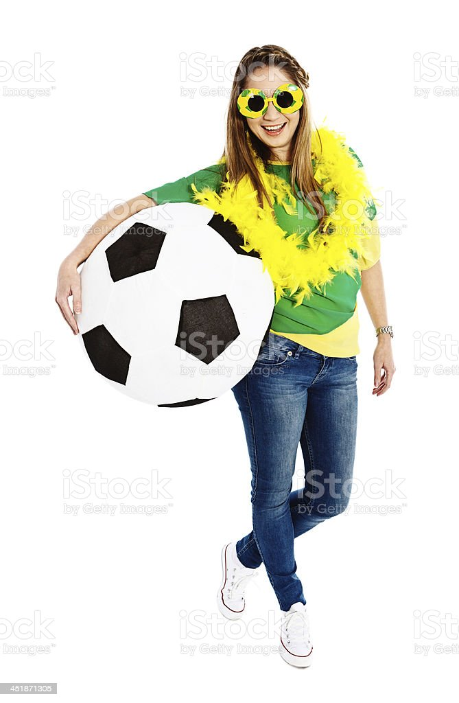Smiling female soccer fan with giant ball royalty-free stock photo