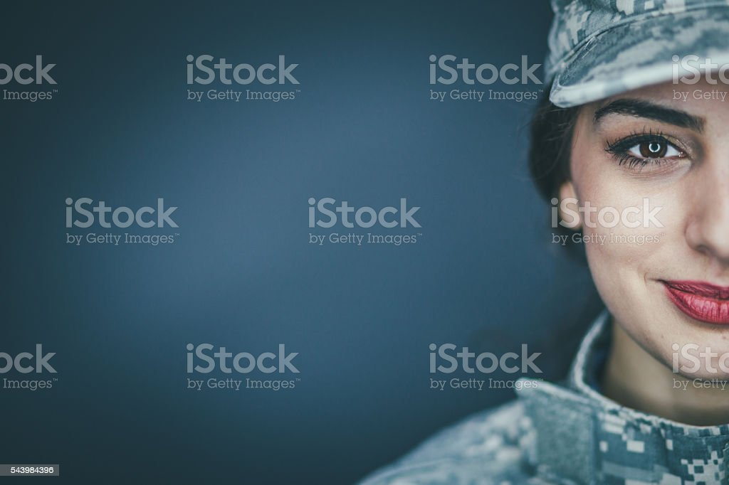 Smiling female soldier stock photo