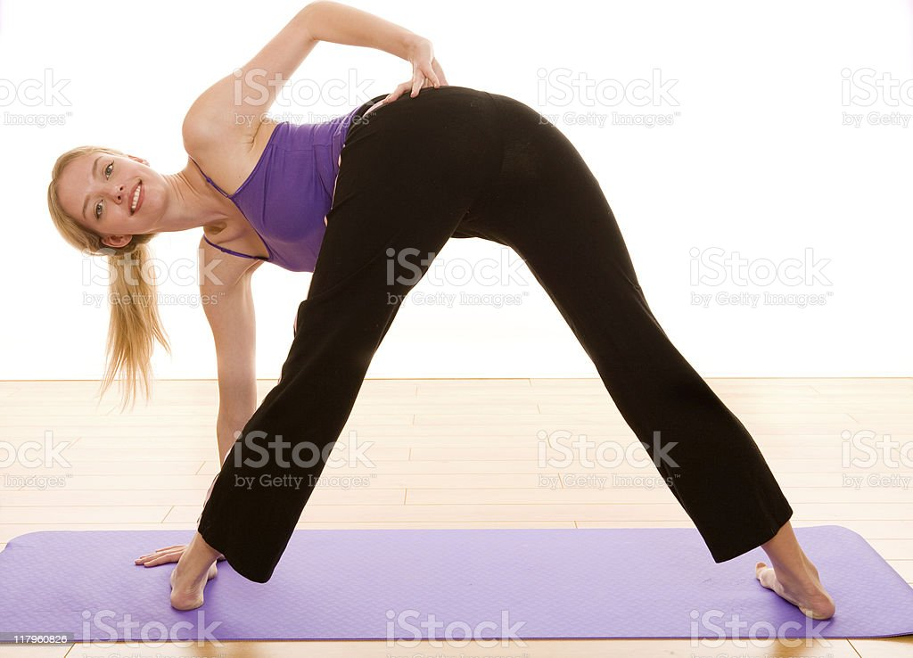 Smiling female stretching royalty-free stock photo