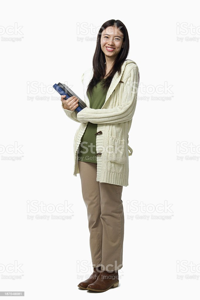 Smiling female student carrying books, portrait stock photo