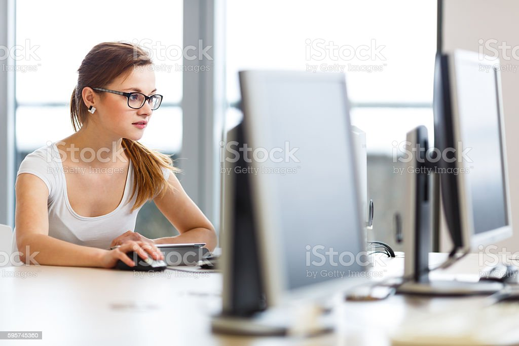 Smiling female student or businesswoman using her tablet computer stock photo