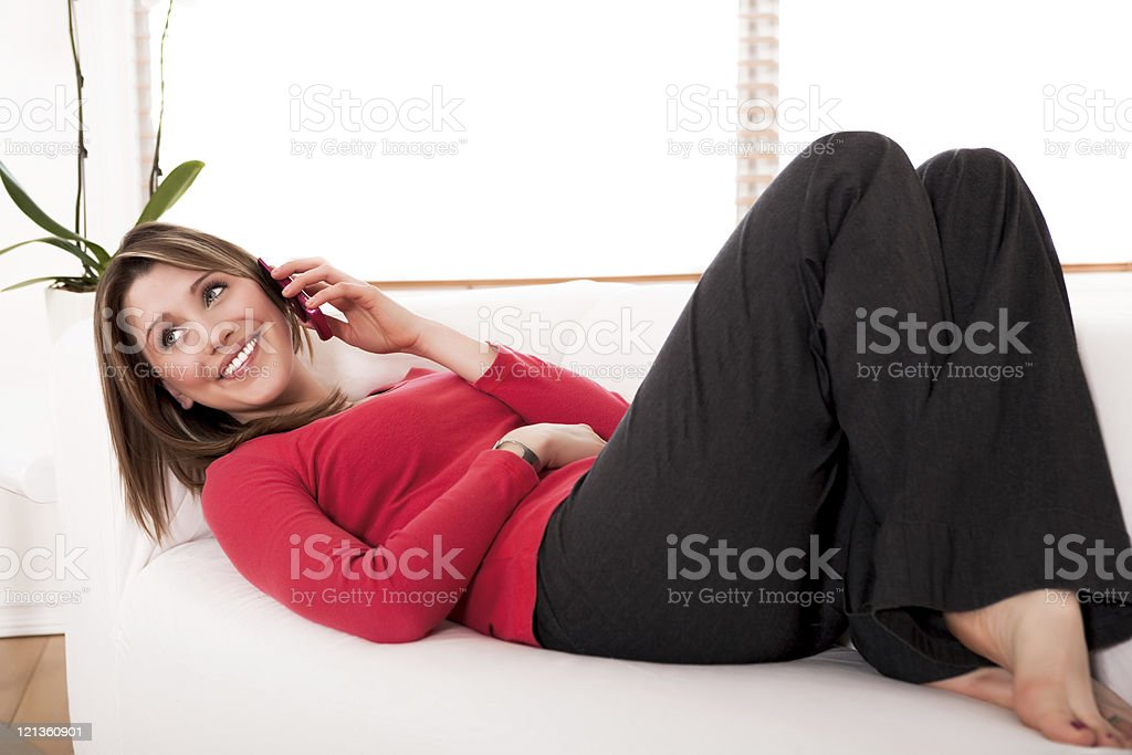 Smiling female talking on her cellphone royalty-free stock photo