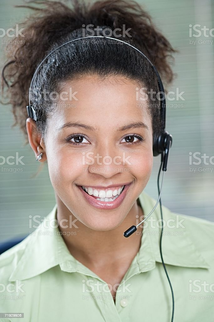 Smiling female telephonist royalty-free stock photo