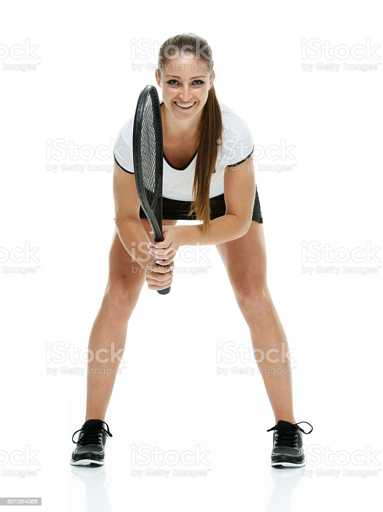 Smiling female tennis player in action stock photo