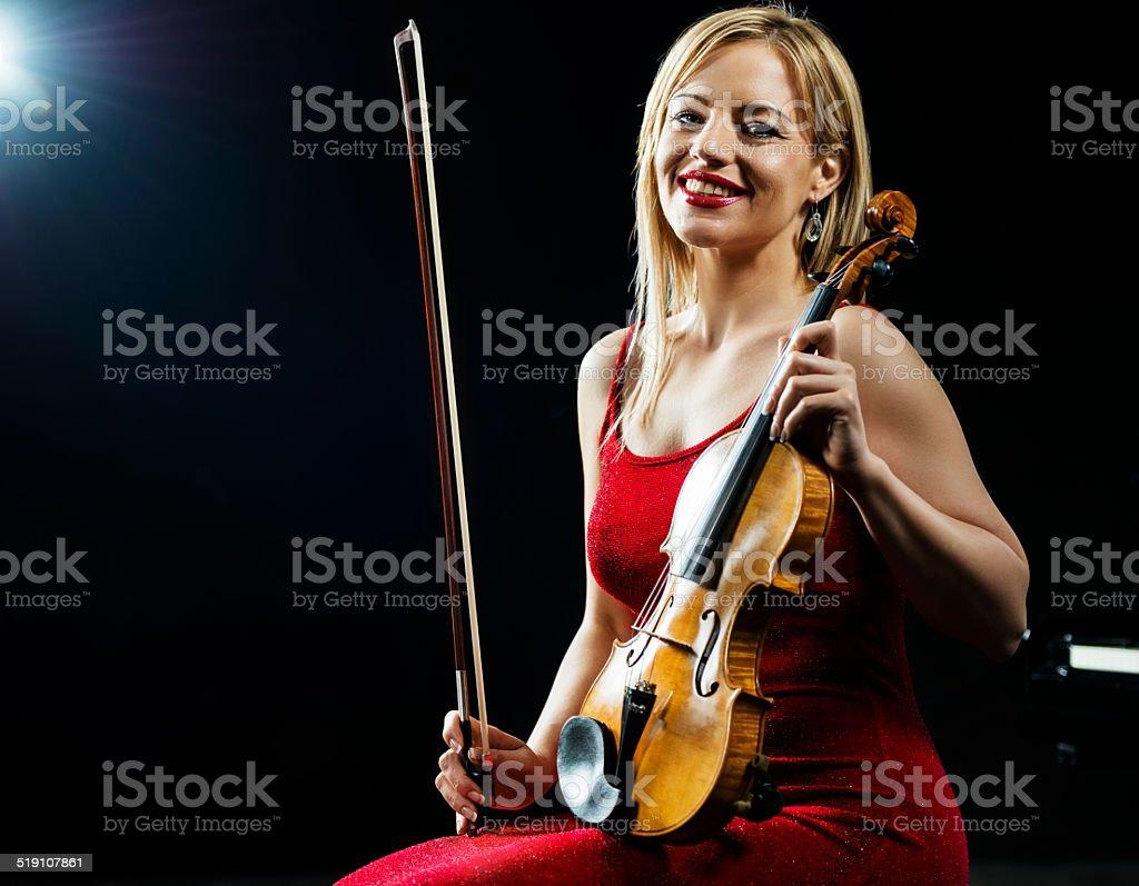 Smiling female violinist. stock photo