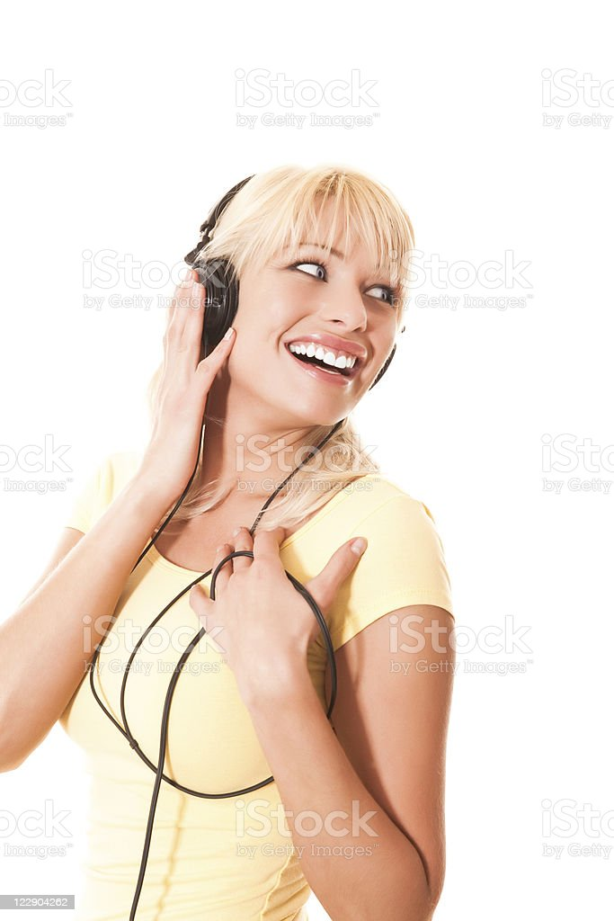 Smiling female with headphones stock photo