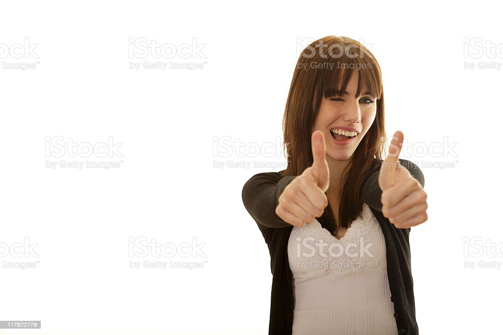 Smiling female with her thumbs up! royalty-free stock photo