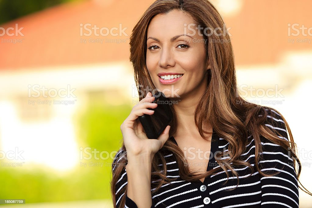 Smiling female with phone stock photo
