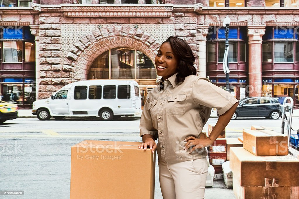 Smiling female worker outdoors stock photo