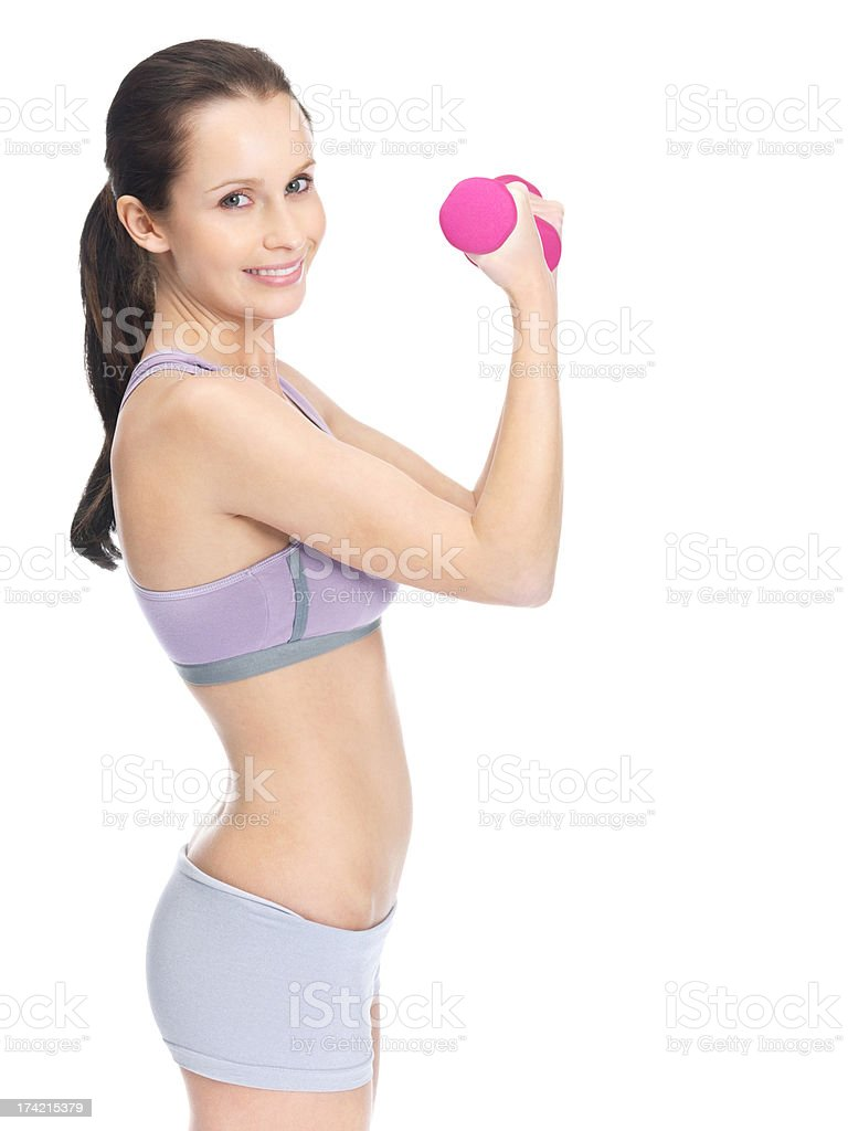 Smiling female working out with pink dumbbells to stay fit stock photo
