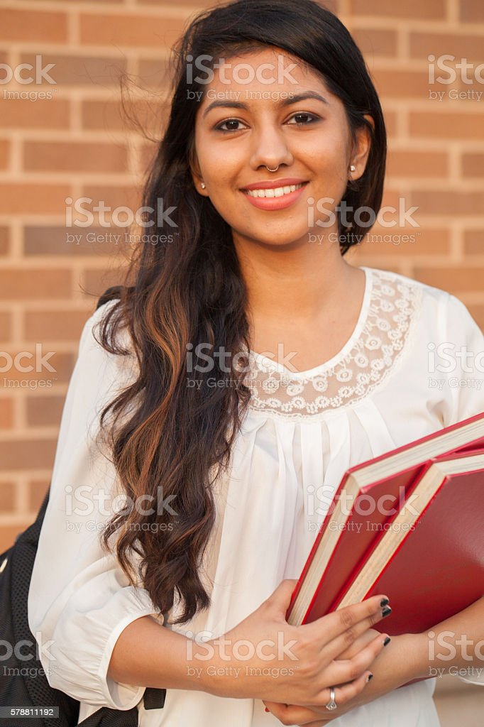 Smiling female young college student of Indian ethnicity stock photo