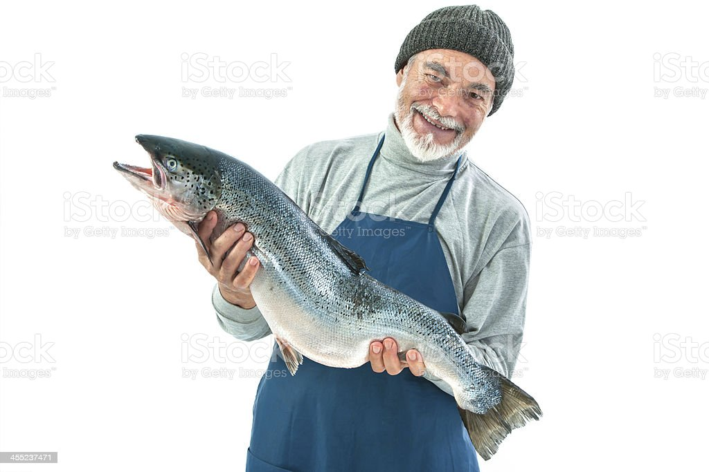 Smiling fisherman holding a big Atlantic salmon stock photo