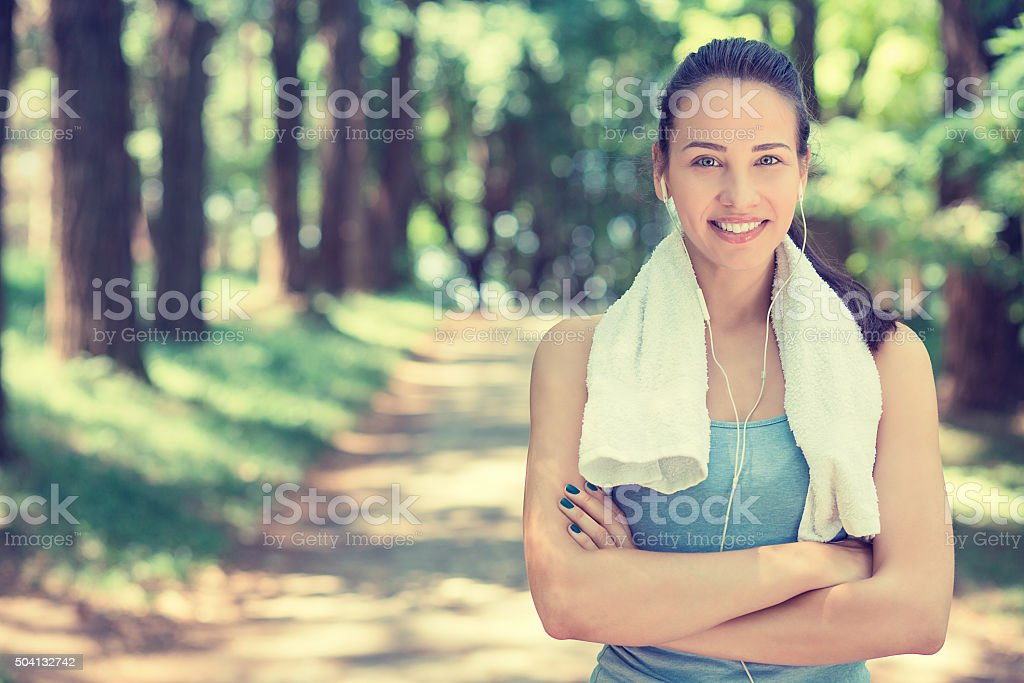 smiling fit woman with white towel resting after workout stock photo