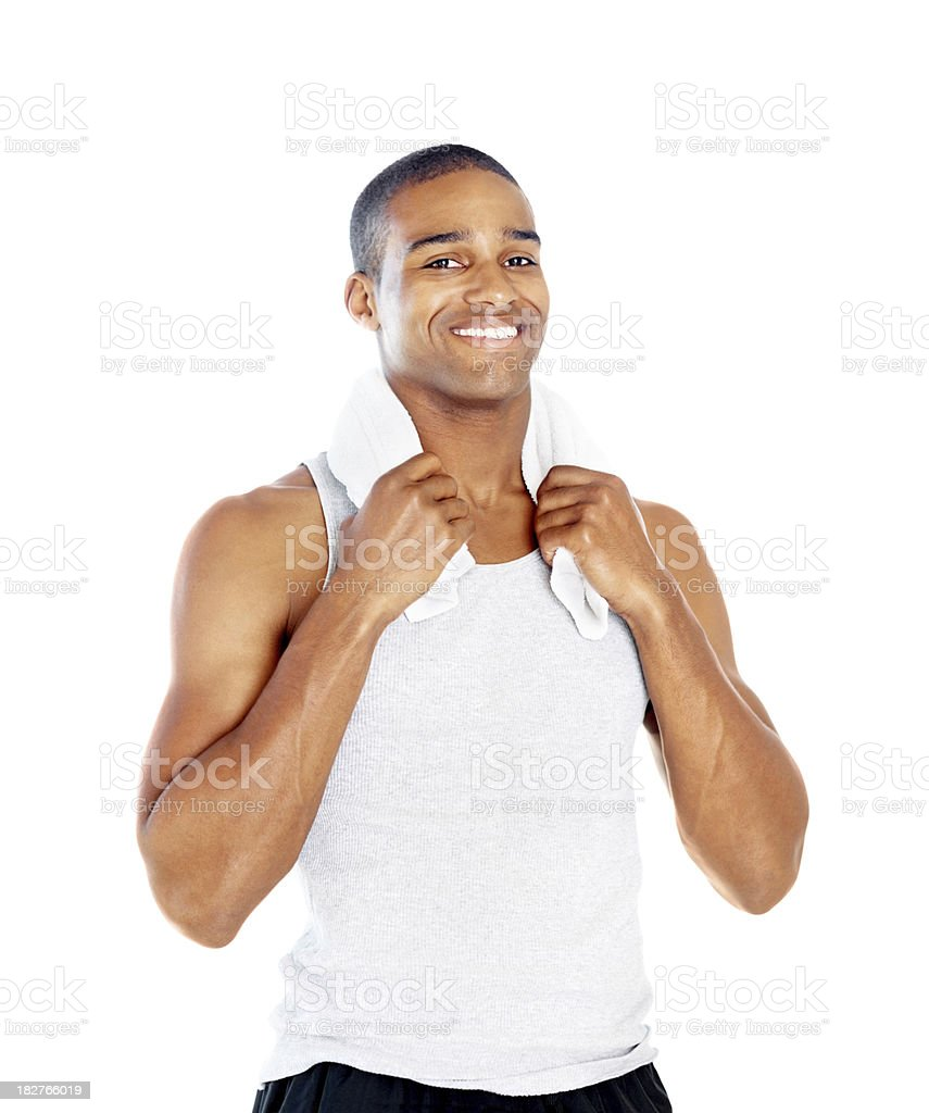 Smiling fitness guy holding a towel around the neck royalty-free stock photo