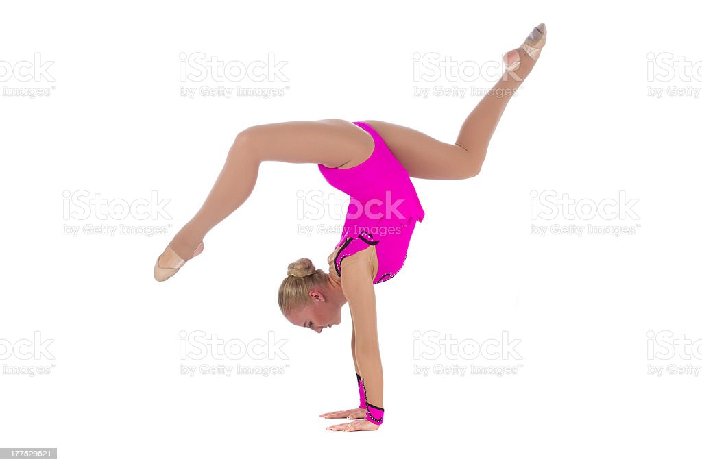 Smiling flexible girl gymnast in a costume doing stretching exercise royalty-free stock photo