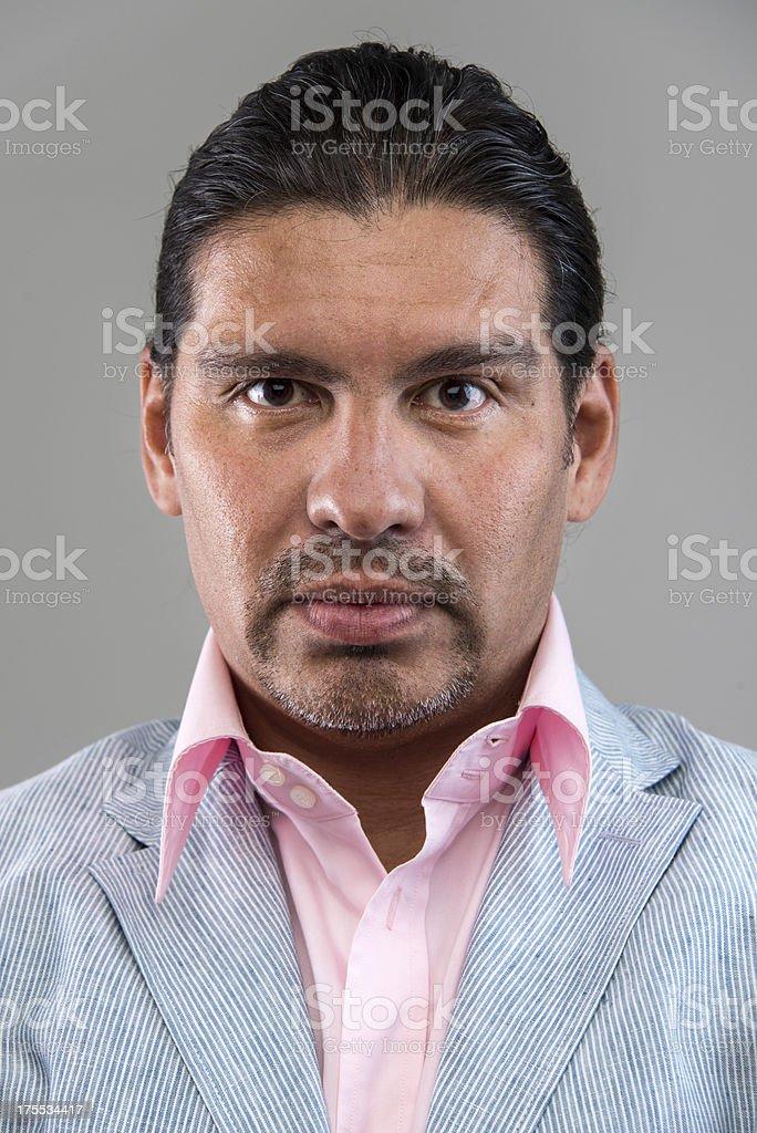Smiling forty something hispanic man stock photo