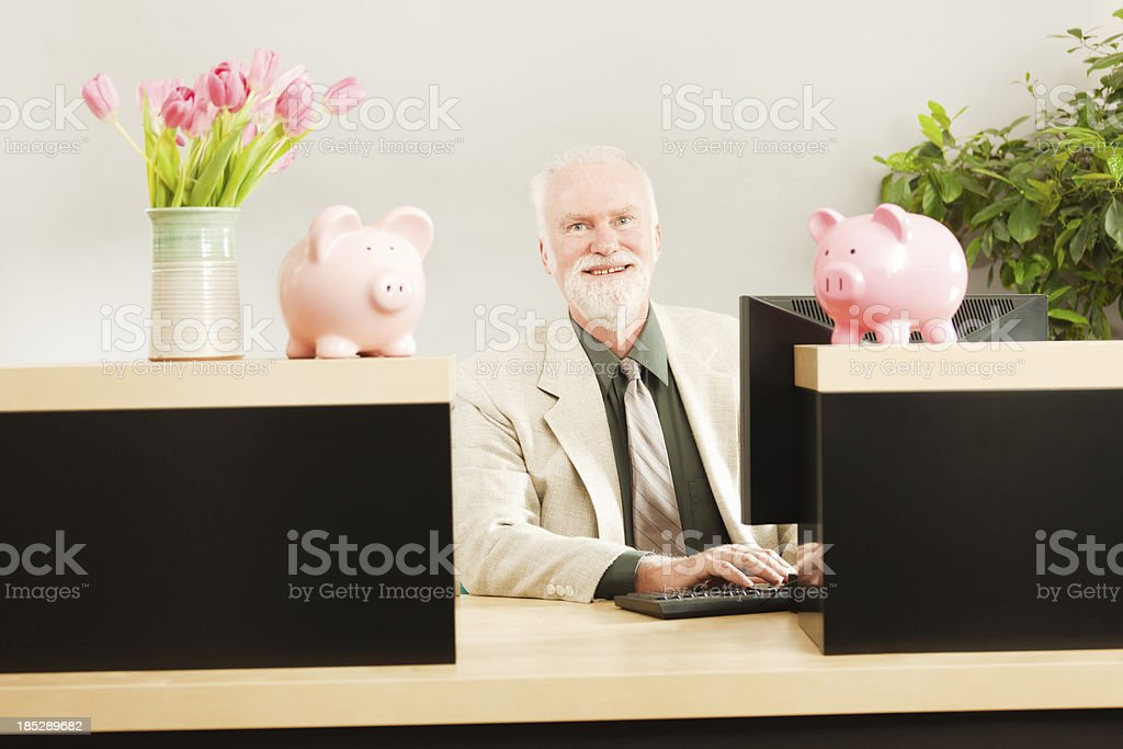 Smiling Friendly Banker Working in Retail Banking Teller Window Hz stock photo