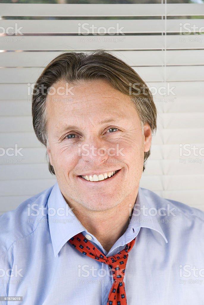 Smiling friendly businessman. royalty-free stock photo