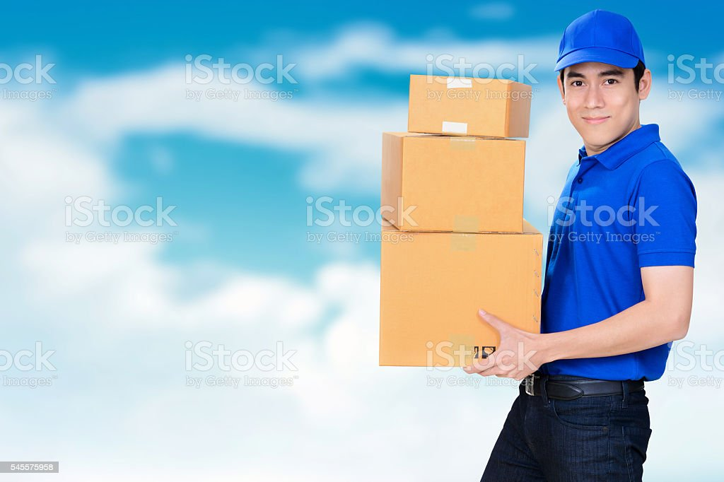 Smiling friendly delivery man carrying parcel boxes stock photo