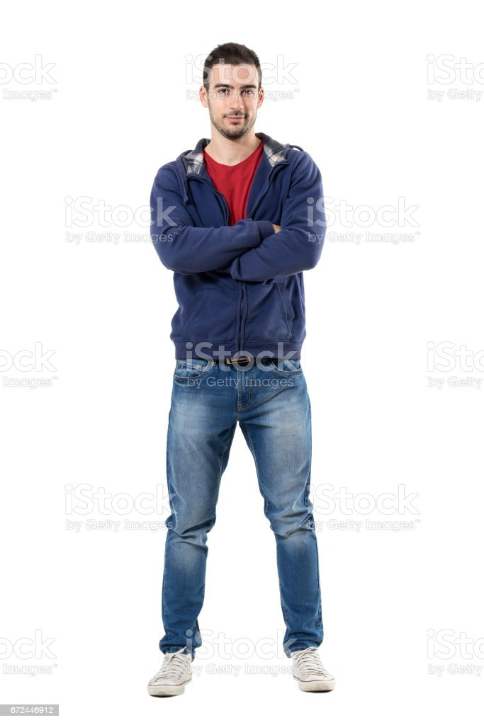 Smiling friendly man in hooded blue shirt with crossed arms looking at camera stock photo