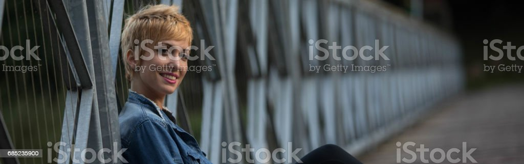 Smiling friendly young blond woman panorama stock photo
