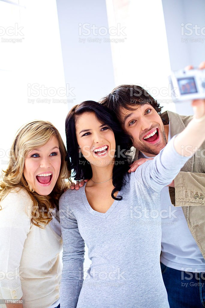 Smiling friends laughing taking self portrait photo royalty-free stock photo