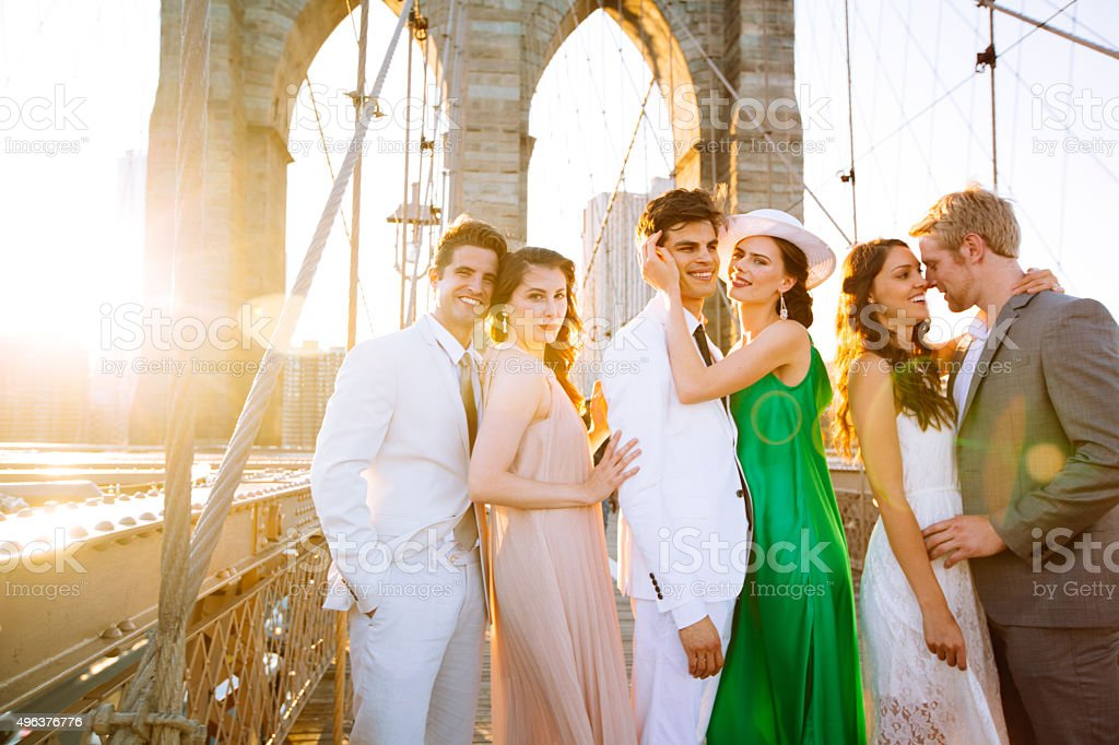 Smiling friends on Brooklyn bridge stock photo