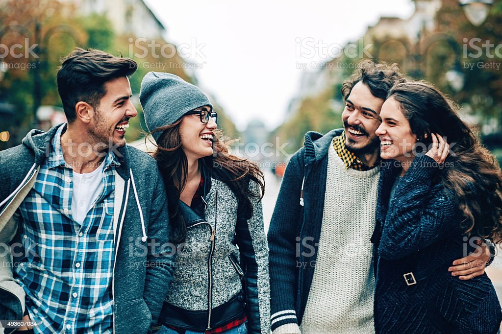 Smiling friends outdoors stock photo