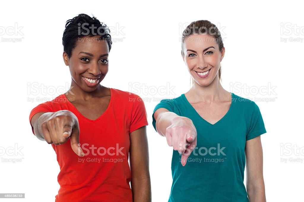 Smiling friends pointing to you stock photo