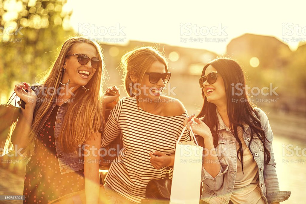 Smiling friends shopping royalty-free stock photo