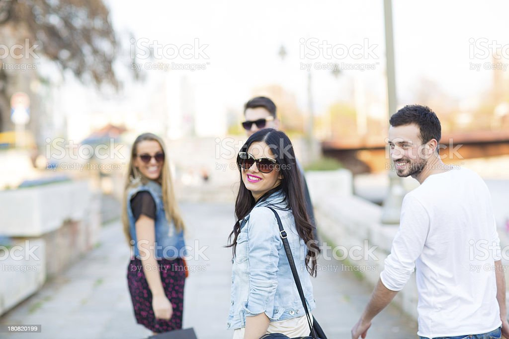 Smiling friends walking on the streets royalty-free stock photo