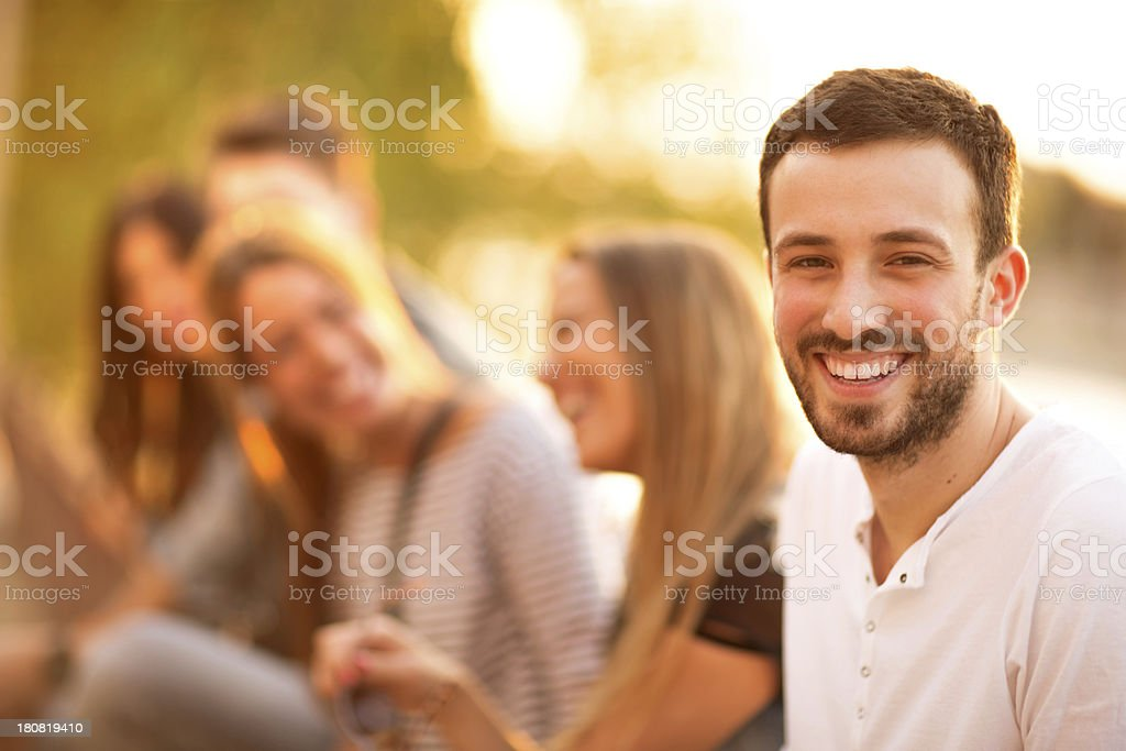 Smiling friends with a focus on the man in front stock photo