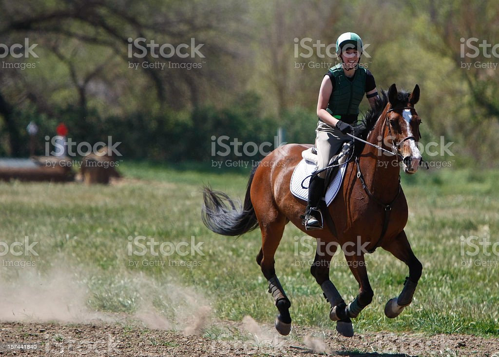 Smiling Galloping Rider stock photo