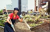 Smiling gardener giving thumbs up in garden