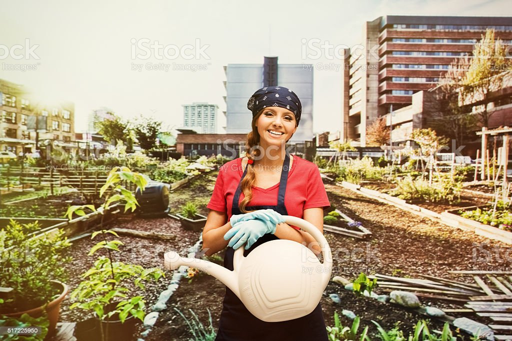 Smiling gardener in the garden stock photo