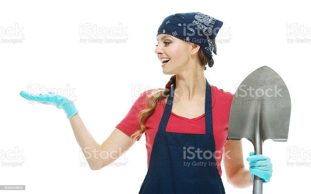 Smiling gardener presenting stock photo