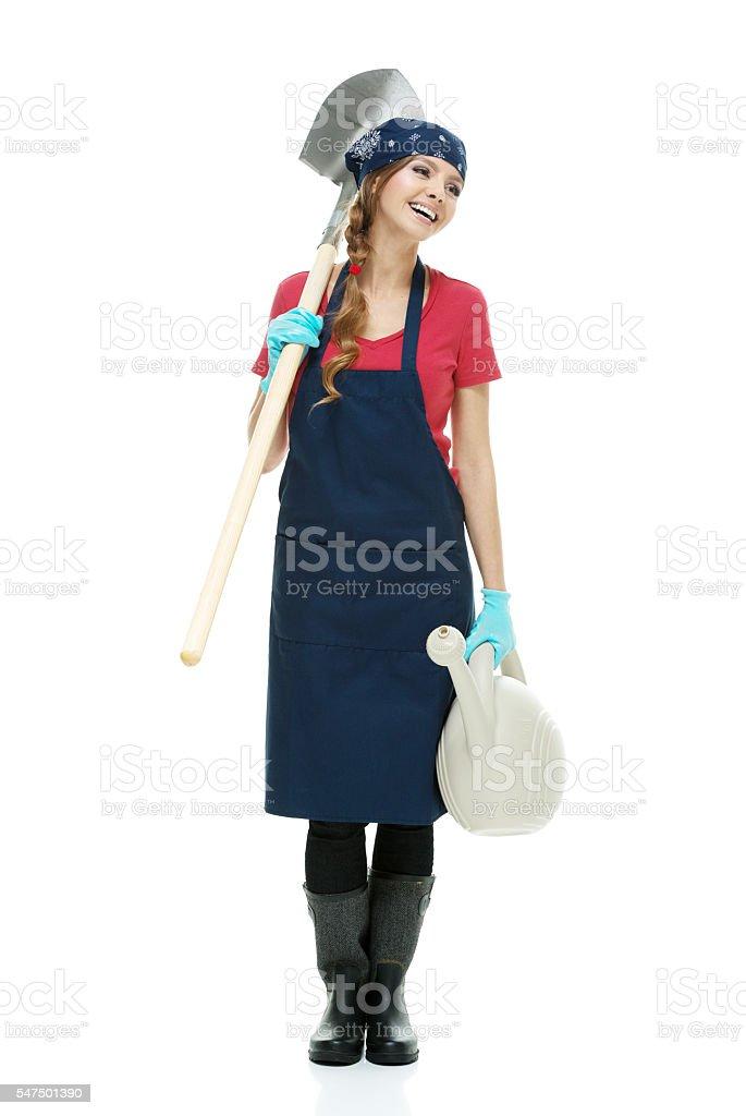 Smiling gardener standing and looking away stock photo