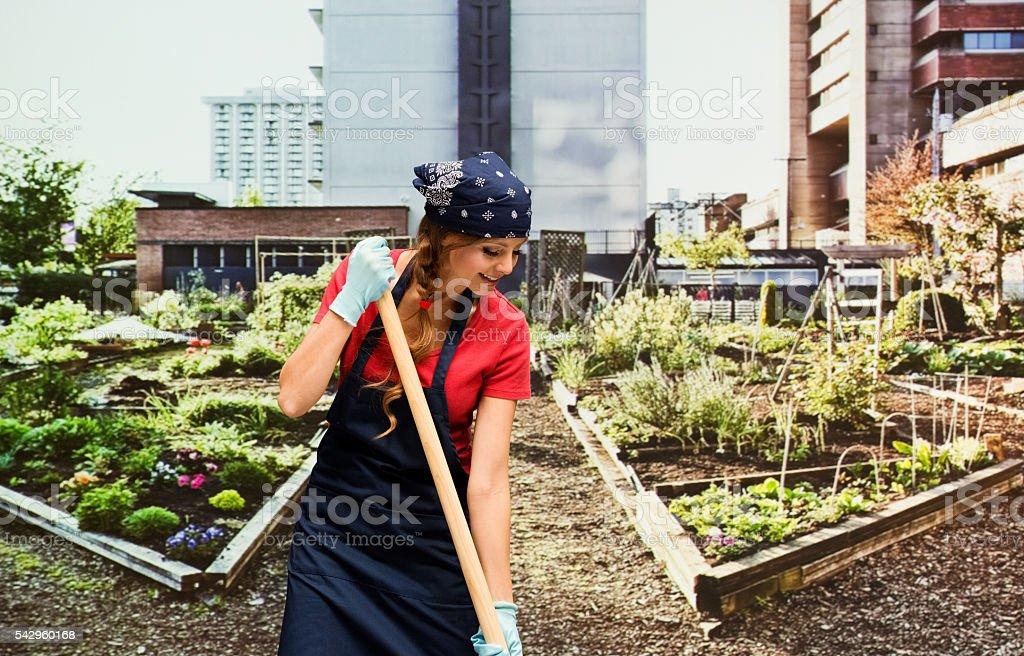 Smiling gardener working in garden stock photo