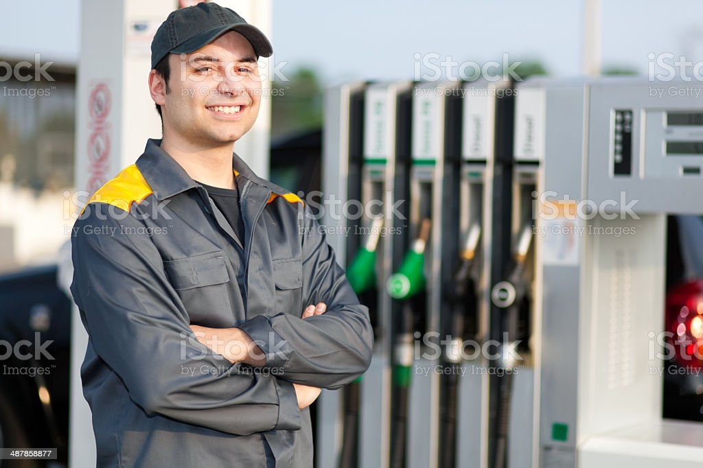 Smiling gas station worker stock photo